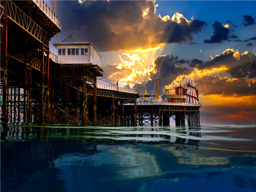 Sunset at the Palace Pier in Brighton by Brighton By ©Brian Roe
