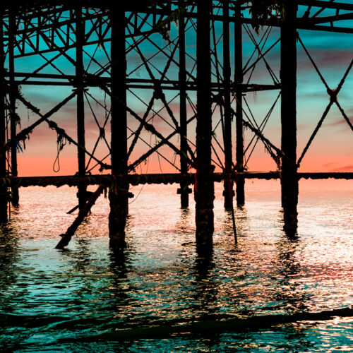 Palace Pier brighton Iron Work in the Sunset by Brian Roe
