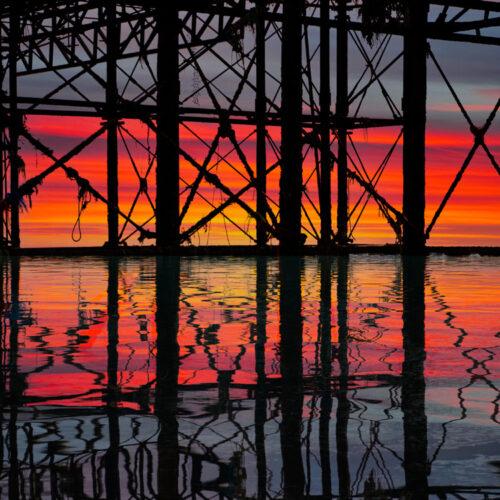 Palace Pier ironwork sunset