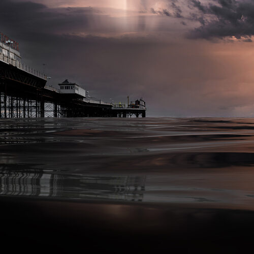 Palace Pier sunburst behind the storm clouds by Brian Roe